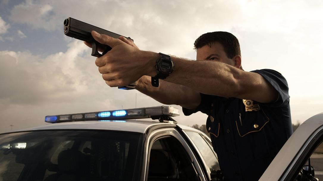 first responder driving glock closeup