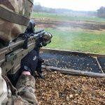 british army SA80A3 rifle shooting downrange