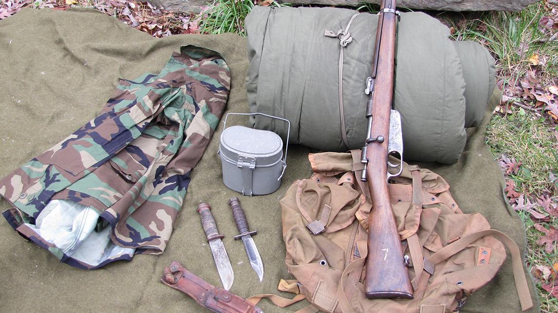 Army Surplus, knives, rifle, clothing, sleeping bag