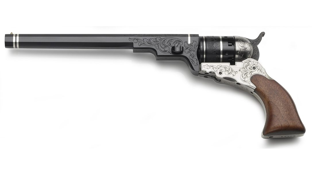 Pietta deluxe model with laser engraving, silver-inlaid brands and a polished steel frame and backstrap.