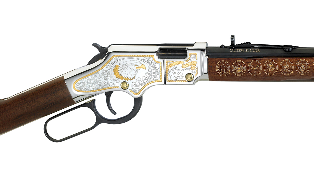 Fine scroll work and and engraving embellish the rifle.