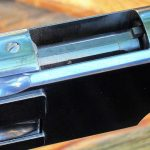 The Winchester 1873 features a sliding dust cover.