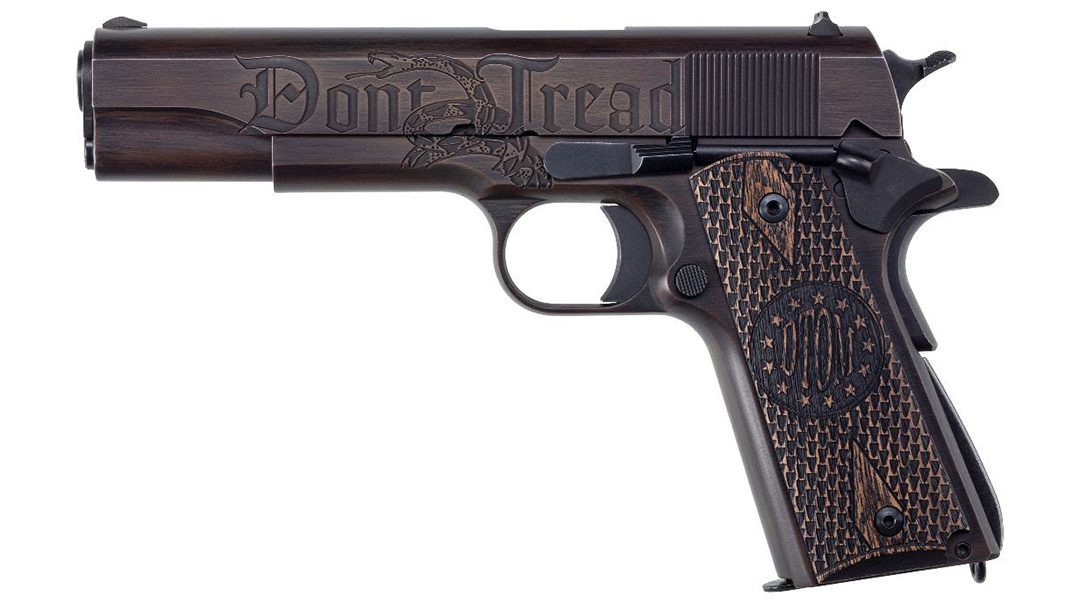 """The left side of the pistol features """"Don't ... Tread,"""" along with images of the Gadsden snake."""