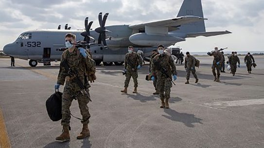 U.S. Marines with 1st Battalion, 25th Marine Regiment, arrive at Kadena Air Base, Okinawa, Japan, on Feb. 28, 2020. Upon their return from the Republic of Korea, the Marines were screened in accordance with U.S. Centers for Disease Control and Japanese government guidelines. III MEF is taking its responsibilities to protect our Marines, Sailors, families, and local communities safe by actively working to prevent the further spread of COVID-19. (U.S. Marine Corps photo by Lance Cpl Ujian Gosun)
