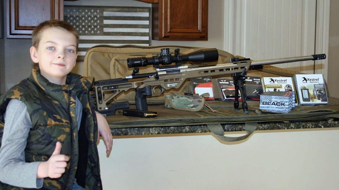 Warne and industry partners presented Paxton Spencer with a long-range shooting kit.