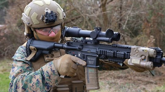 CWO4 Dave Tomlinson, infantry weapons officer at Marine Corps Systems Command, demonstrates the Squad Common Optic attached to the M27 Infantry Automatic Rifle, Feb. 10, aboard Marine Corps Base Quantico, Virginia. The SCO is an improved optic that improves target acquisition and probability of hit with infantry assault rifles. Marine Corps Systems Command began fielding the system to infantry and infantry-like units this year.