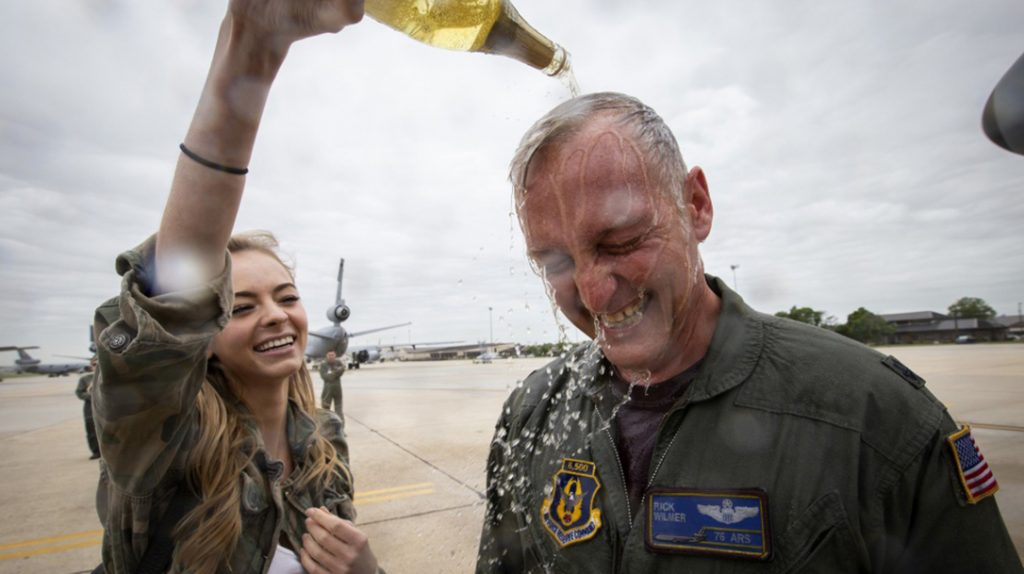 US Air Force Lt. Col. Frederick M. Wilmer III, a KC-10 Extender pilot with the 76th Air Refueling Squadron, 514th Air Mobility Wing, has apple cider poured on him by his daughter, Samantha, after completing his final flight at Joint Base McGuire-Dix-Lakehurst, N.J., May 18, 2018.