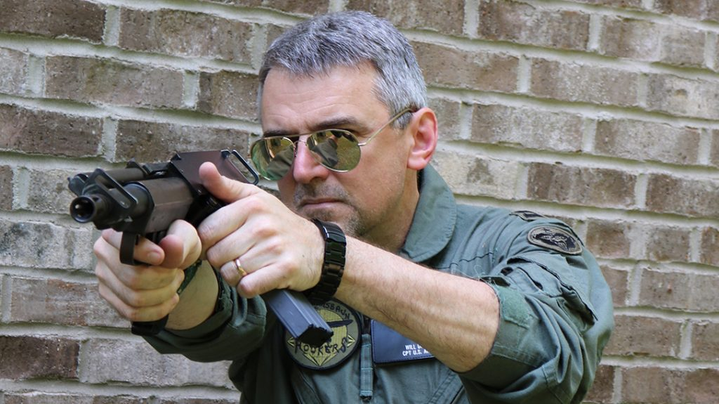 The Bushmaster Arm Pistol was an ambidextrous bullpup survival pistol that ejected out the top. The steel stud behind the ejection port is the reciprocating charging handle.