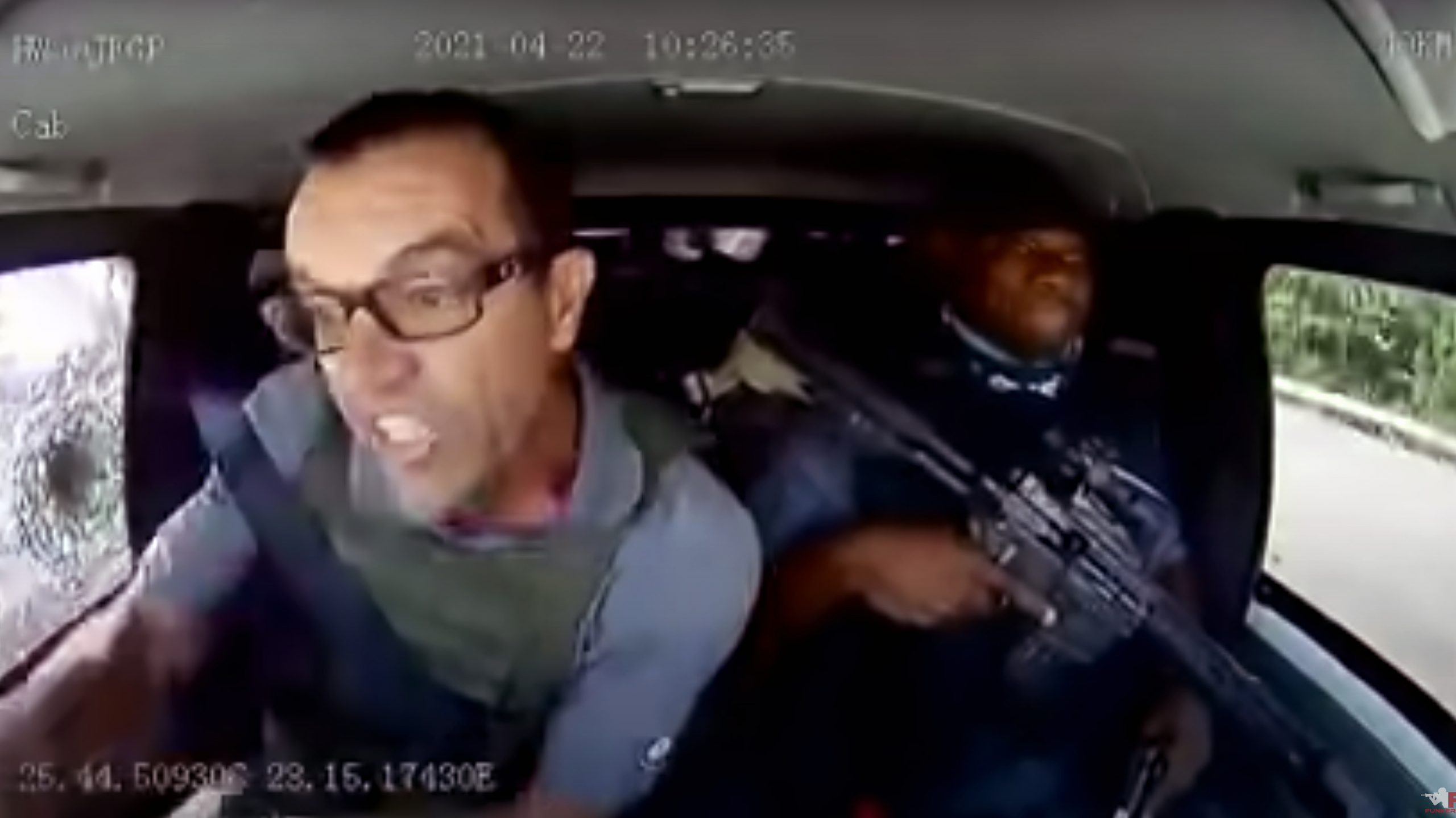 An armored car driver held off an armed attack and kept on driving.