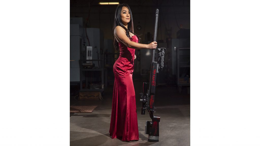 Hoang turns heads here in a formal dress, but also with her performance on the range.
