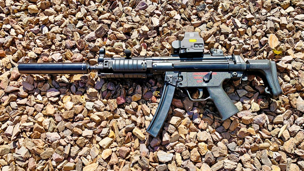 A select-fire MP5 SMG with a thread-on SEG H 9mm suppressor.
