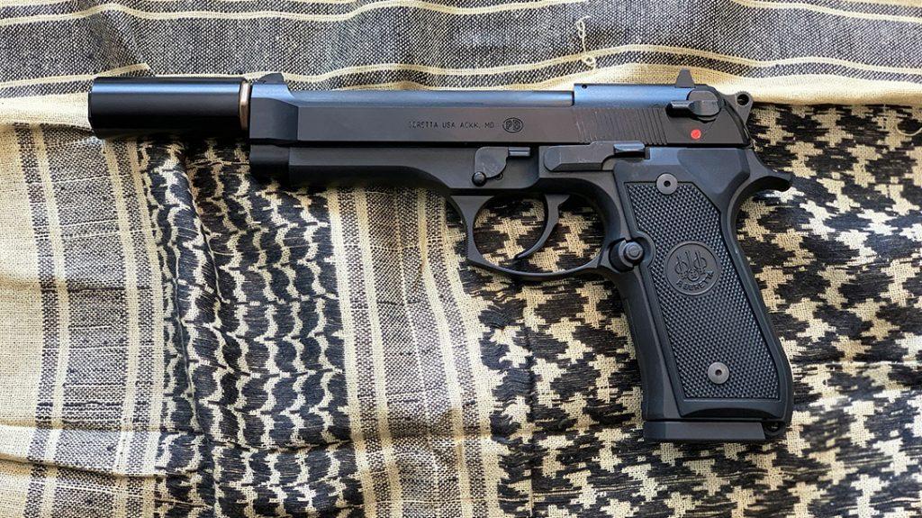 A Beretta M9-22 with the short Rex Silentium COV 22 mini suppressor in .22 LR.