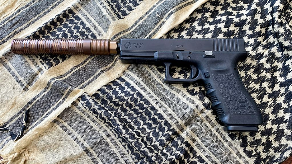 A Tactical Solutions Glock 17/22 with the MG22 Extreme Duty .22 LR suppressor.