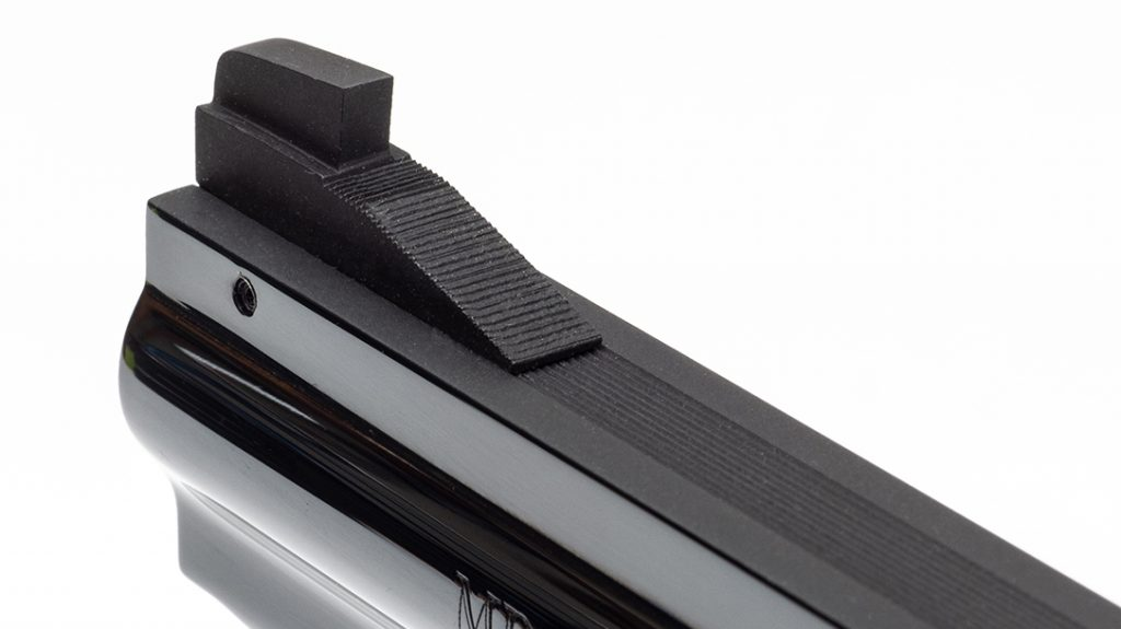 The front sight is a black blade, and the sight ramp is serrated for glare reduction.