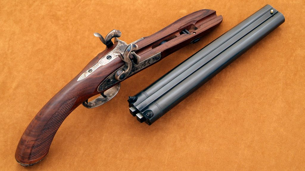 The Howdah model has the barrels welded with two central ribs, as would be a shotgun. There are two lugs on the back of the barrels that fit into corresponding recesses in the tang. The barrels are secured to the stock by a single wedge passing through the barrel tenon.