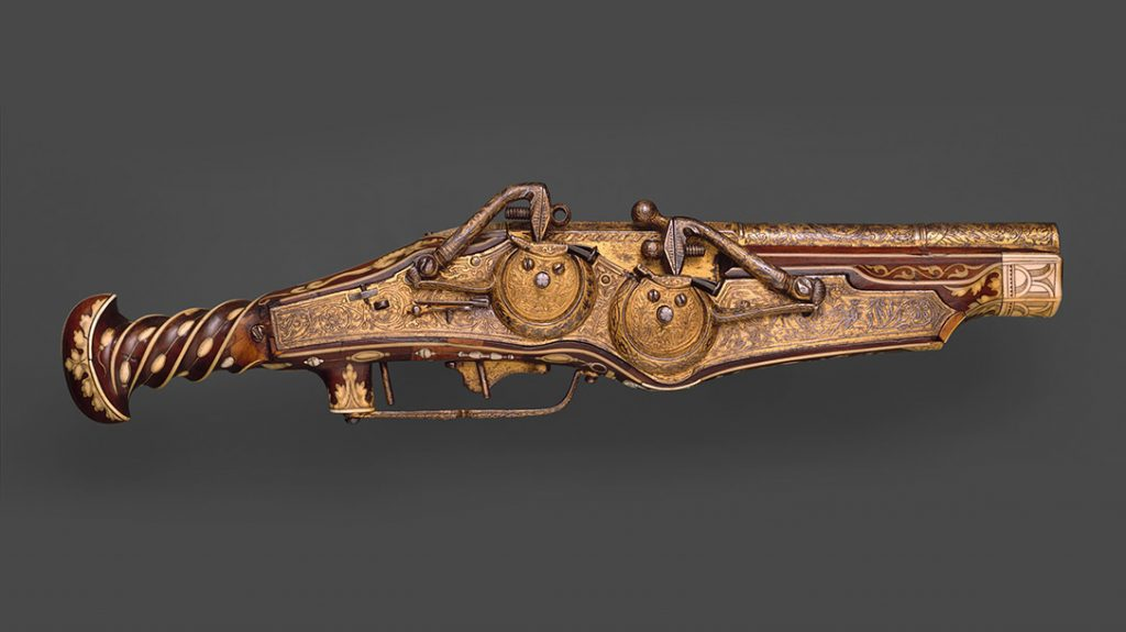 One of the earliest double-barrel pistols, this firearm was designed and produced by Peter Peck—maker of watches and guns. The two locks combined in one mechanism provided the barrels with separate ignition. Made for Emperor Charles V (reigned 1519–56), the pistol is decorated with his dynastic and personal emblems. It includes a double-headed eagle and the Pillars of Hercules with the Latin motto PLUS ULTRA (More beyond). (Metropolitan Museum of Art)