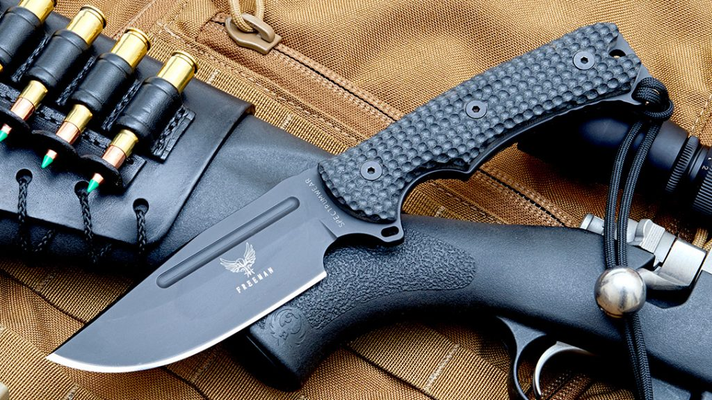 A 5-inch Model 451 clip point in black with dimpled, 3D-machined G-10 handles and paracord lanyard.