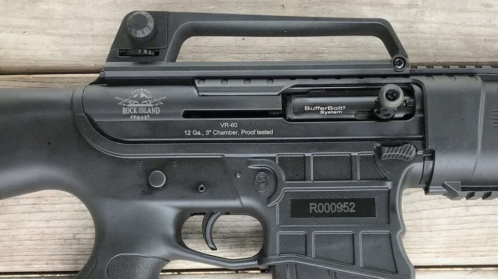 The right side of the VR60 receiver shows it uses a magazine catch like the one on an M4. It also has an A2-type removable carry handle, and the charging handle is attached to the bolt itself.