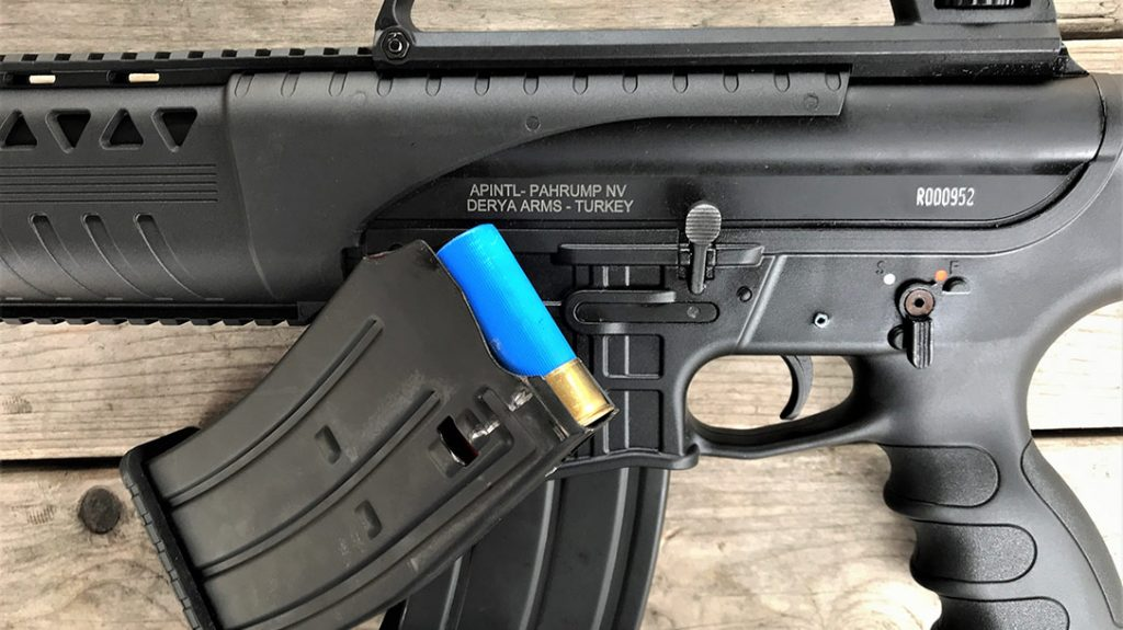 This left-side receiver view shows the AR-like safety and bolt release latch. The AR-style box magazine holds five shotshells.